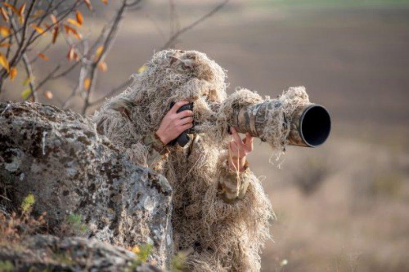 Tierfotograf mit Tarnung